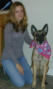 Nicole with her first championship canine. Chloe has won over a dozen competitions for protection and obedience.