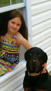 Seven year old Abbie handling a three year old Rottweiler.